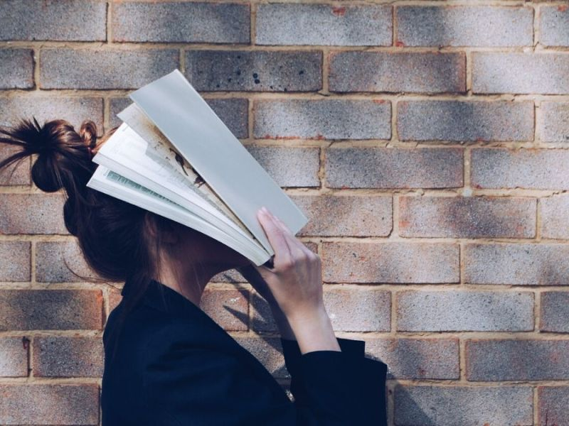 Book over face, face, brain, woman, book,